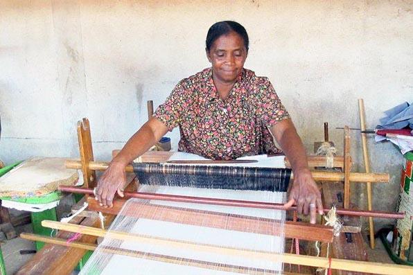 MALAGASY LADY WITH SILK LOOM